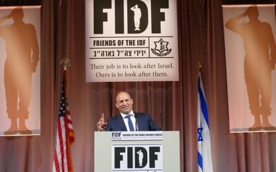 Education and Diaspora Affairs Minister Naftali Bennett speaks at the FIDF gala May 8.