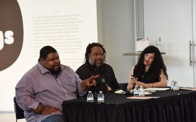 "Michael Twitty (left), food writer Von Diaz and visual artist Michi Meko sit on the ""Listen to Your Gut"" panel April 19."