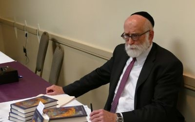 Rabbi Moshe Miller signs and sells books May 11 to benefit the Tzarkei Naomi Fund.