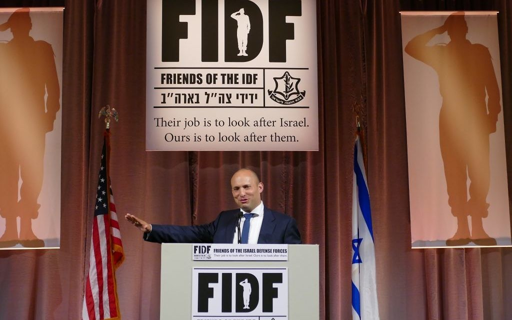 Israeli minister of education and Diaspora affairs Naftali Bennett addresses guests during the FIDF gala.