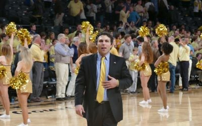 Businesses can learn from Josh Pastner, shown enjoying the atmosphere of Georgia Tech's final regular-season home game Feb. 28. (Photo by David R. Cohen)