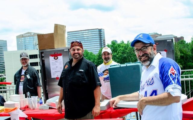 Rabbi Reuven Stein, the Atlanta Kosher Commission's director of supervision, keeps an eye on the operations of Keith Marks and his Keith's Corner Bar-B-Que crew during Kosher Day.