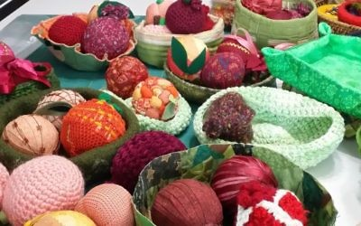 Pomegranates and peaches made for use in convention centerpieces are shown in the home studio of Cheryl Miller during a pre-convention Peach State Stitchers stitch-in for the centerpiece project, co-chaired by Miller and Pamela Rishfeld.