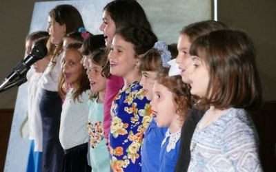 It's singing time for the first- and second-grade girls.