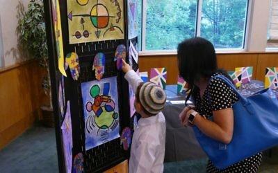 A proud pupil presents his artwork.