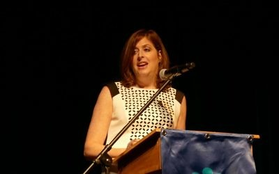 Head of School Amy Shafron welcomes guests to the Davis Academy's eighth-grade graduation.