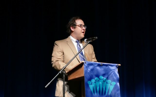 Rabbi Micah Lapidus, shown delivering the invocation to the Class of 2017 at the Davis Academy, is a man of music throughout the year.