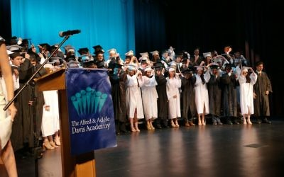 The Davis Academy Class of 2017 follows tradition by flipping tassels from right to left to mark graduation.
