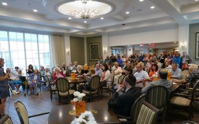 Speaking in the new farm-style dining hall, Jewish Home Life Communities board Chairwoman Deborah Maslia says the upgraded facility matches quality of the Cohen Home's care and service.