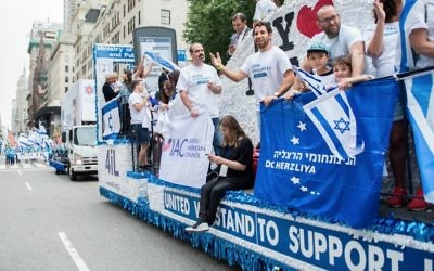 Photos by Alexi Rosenfeld Israel supporters turn New York's Fifth Avenue blue and white Sunday, June 4.