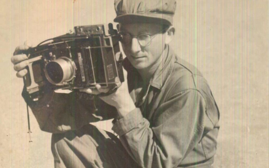 At the age of 55, Adolph Rosenberg found himself playing the impromptu role of war correspondent. In this photo, a much younger Rosenberg tests out a camera.