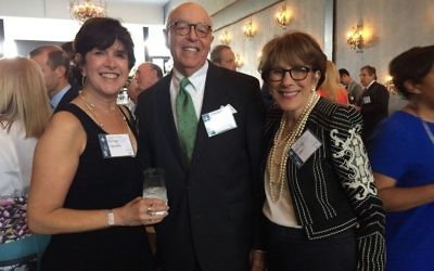 Cindy Paradies (left) talks with last year's Selig Award honorees, Tom and Spring Asher.