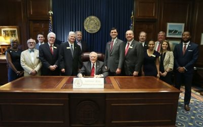 Judge Gary Jackson (two to the right of the governor) is among several lawmakers and judicial officials joining Gov. Nathan Deal at the signing of H.B. 370 on May 8.