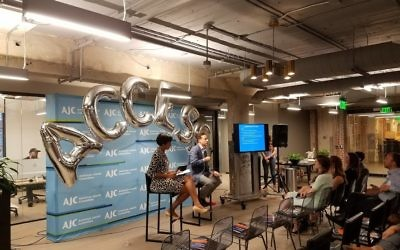 Jamestown CEO Matt Bronfman and event moderator Leah Fleming chat at American Jewish Committee's ACCESS in the ATL June 22 hosted at Industrious inside of Ponce City Market.