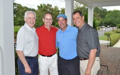 Photo by Eagleshotz Enjoying the Harry Maziar Classic are (from left) Harry Maziar, honoree Doug Kuniansky, event chair David Kusiel and JCC board Chair Joel Arogeti.