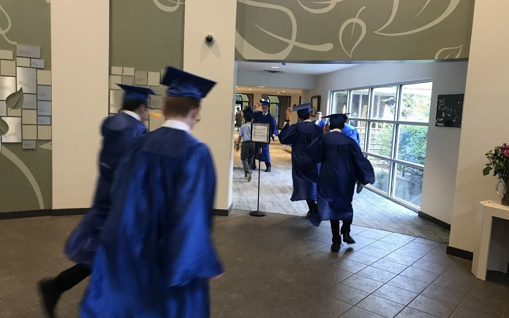 Torah Day graduates run to line up for the ceremony.