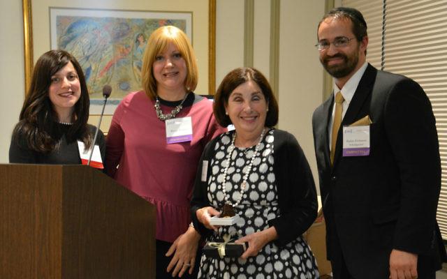 Pesha Izenberg (left), Marcy Kalnitz and Rabbi Elchanan Schulgasser, Torah Day School's senior development manager, present a thank-you gift to donor Gail Ripans.