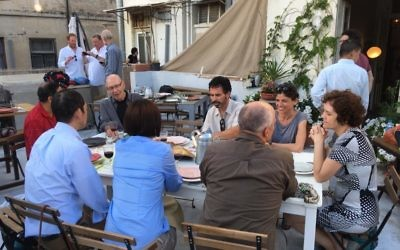 Some of the 26 fellows enjoy the social side of Israel.