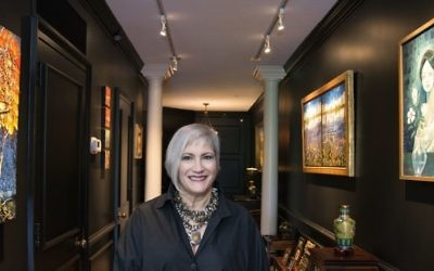 "Sharon Silva's entrance art gallery includes ""Lunar Ambition"" (left) by Ford Smith and ""Blue Lady 1953"" (right) by Angel Oblitas."