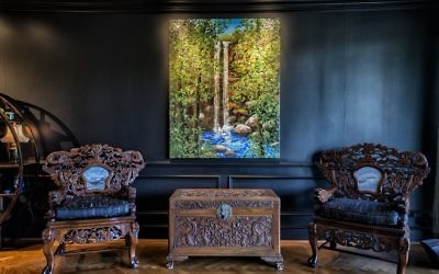 "Sharon Silva's heavy carved rosewood chairs flank M. Stuart's ""Toccoa Falls."""