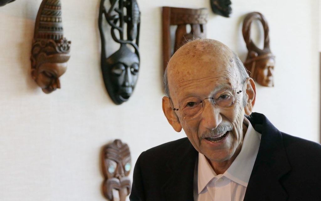 John Silva, who escaped Germany after Kristallnacht, discusses his collection of masks and rare ivory (acquired in eastern Asia in the 1950s). (Photo by Duane Stork)