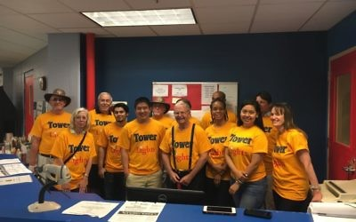 Michael Greenbaum poses with Tower Lights members at a volunteer event.