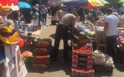 The intertwined Israeli and Palestinian economies converge at places such as the main market in Ramallah.  (Photo by Rabbi Joshua Heller)