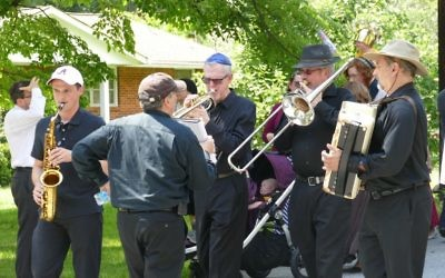 Musicians lead the way during the Torah parade from the Schloss home down Breezy Lane to Beth Jacob.
