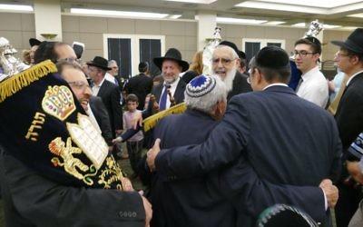 Ecstatic dancing celebrates the new Torah at Beth Jacob.