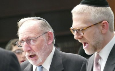 Fred Glusman (left), the chaplain at Berman Commons, is part of the men's choir at the dedication.