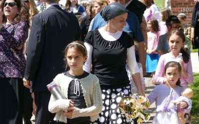 Women and girls join the Torah parade from the Schloss home to Beth Jacob.
