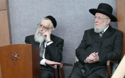 Rabbis Emanuel Feldman and Israel Meir Rau listen to Rabbi Ilan Feldman's speech.