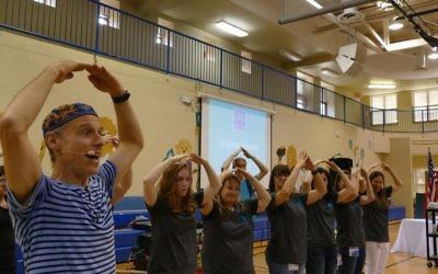 Third-grade teachers (from left) Caroline Patterson, Lea Artzi, Dana Richin, Jennifer Rainbow, Sharone Bolnik and Michelle Mittleman learn a new dance from Billy Jonas.
