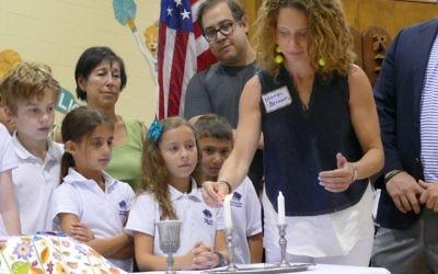 Mara Berman lights the Shabbat candles.