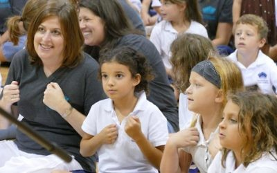 Davis Academy Head of School Amy Shafron shares an interactive moment with students during a performance by Billy Jonas.