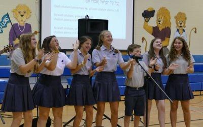 Rachel Hertz, Zoe Shapiro, Margo Kaye, Alexa Warner, Alex Newberg, Kady Herold and Emma Perlstein join in song and prayer during Kabbalat Shabbat.