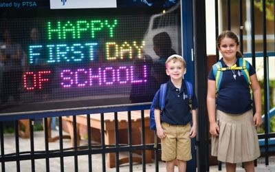 Having the entire school on one campus on Northland Drive means smiles on faces of a wide range of ages in celebration of the start of the school year.