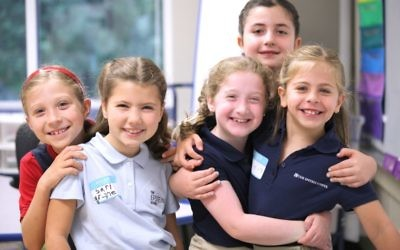 Epstein School second-graders (from left) Amelit Hall, Sari Grant, Isla Gingold, Talia Bock and Lali Stillman reconnect on the first day after their summer break.