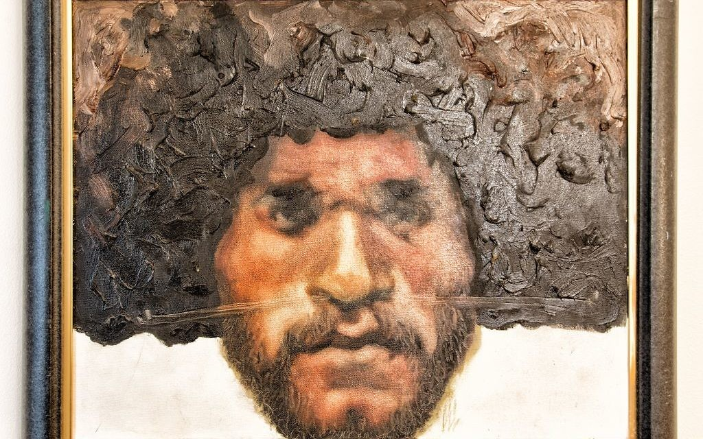 """The Venzer oil painting """"Huli Warrior"""" from Papua New Guinea shows off the subject's matted wig."""