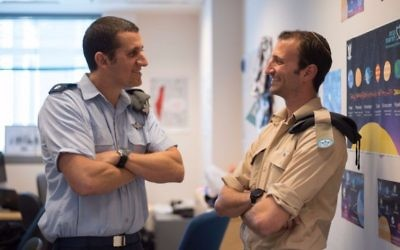 Sgt. Ilan Regenbaum (right), who made aliyah from Atlanta, speaks with his commander, Maj. Omer Yuval, in the Israeli air force Innovation Unit. (Photo courtesy of the IDF Spokesperson's Unit)