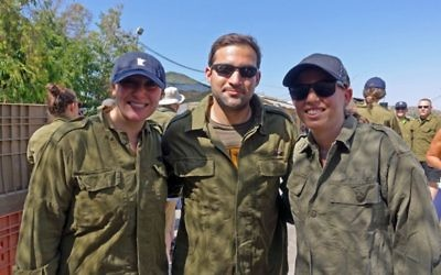 Photos courtesy of FIDF Allison Oreck (left), Ben Levy and Shaina Gordon visit Israel on this summer's FIDF Young Leadership Mission.