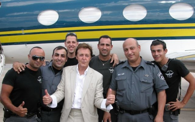 Photo by Yuval Erel Paul McCartney poses with Israeli police before his performance in 2008.