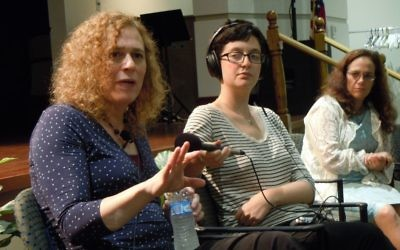 Joy Ladin (left) speaks during her appearance at the Selig Center on Aug. 17. Rebecca Stapel-Wax (right), the executive director of event sponsor SOJOURN, listens.