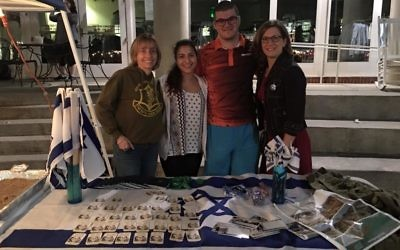 Rabbi Judith Schindler (left) is joined by Inbal Ozeri, Noah Goldman and Talli Dippold at the Israel table at the Queens Trip Around the World event.