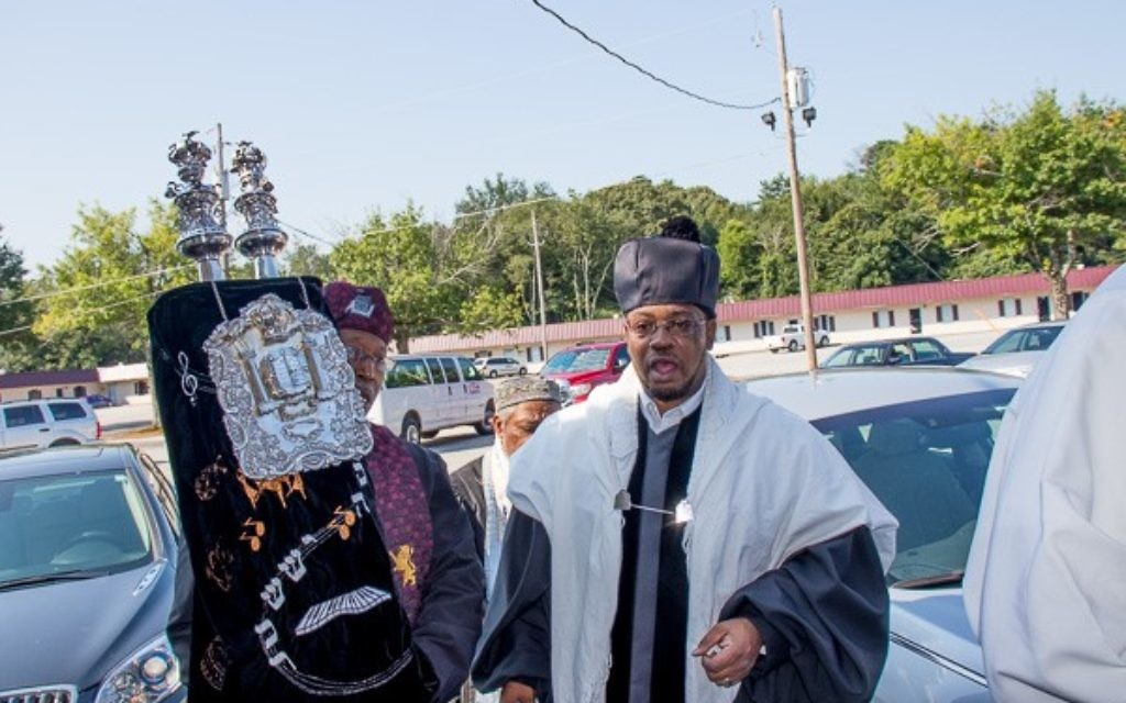 Rabbi Shalem Jeshurun (right) and the Torah process into Congregation Or-Ami in College Park at the start of Saturday services. (Photo courtesy of Rabbi Sholomo Ben Levy)