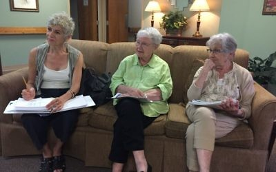 (From left) actress Mary Lynn Owen and Jewish Tower residents Lila Rosenbaum and Eunice Stein talk about Yiddish. (Photo by Audrey Galex)