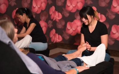 Guests receive a foot massage at Treat Your Feet.