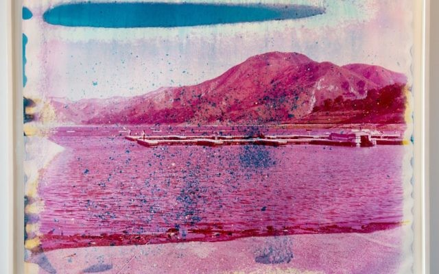 "Pink-hued ""Yuba Lake #7"" is from Matthew Brandt's ""Lakes & Reservoir Series,"" in which the artist soaks the work in the lake water it represents to break down the photographic image."