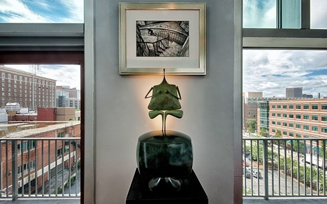 "French sculptor Philippe Hiquily's ""La Croqueuse de Diamants"" sits below the photograph ""Hyeres"" by Henri Cartier-Bresson."