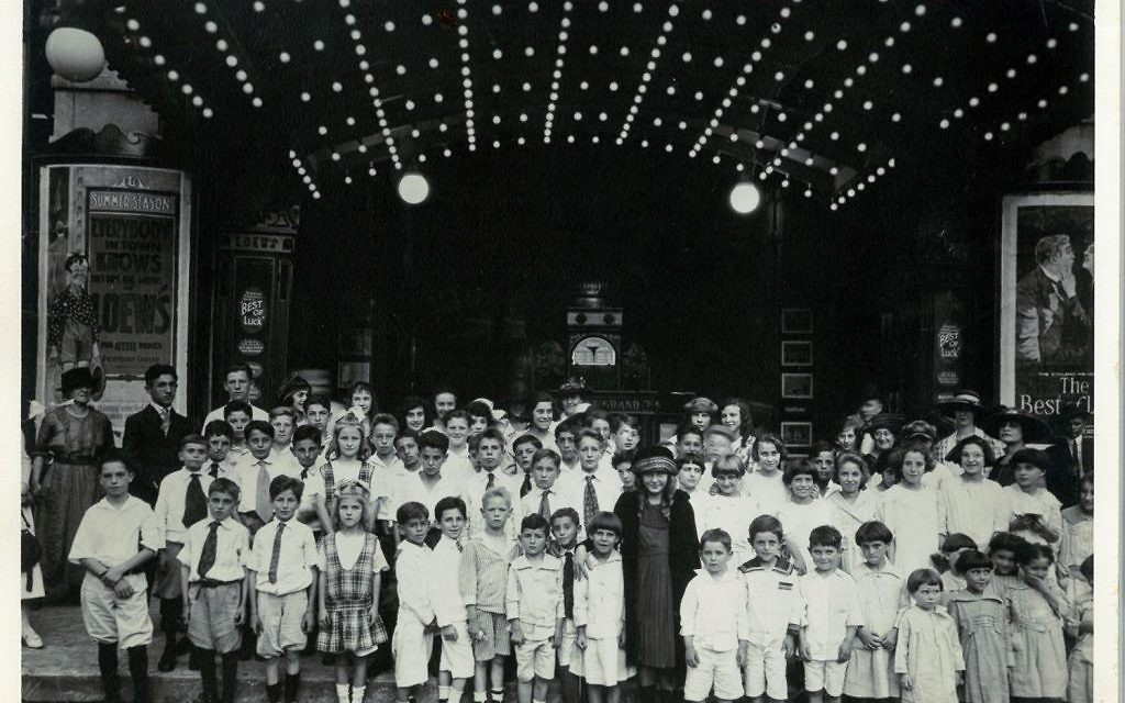 Photo from the Simon Scher Family Papers, Cuba Family Archives for Southern Jewish History, Breman Museum Residents of the Hebrew Orphans' Home take an outing to Loew's Theater in Five Points around 1920.